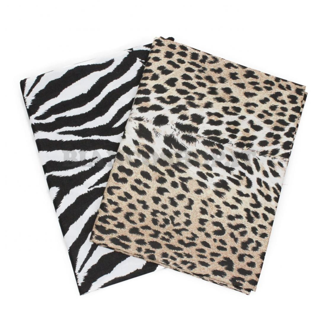 Telo copritutto animalier zebrato o maculato chiodi for Telo arredo copritutto